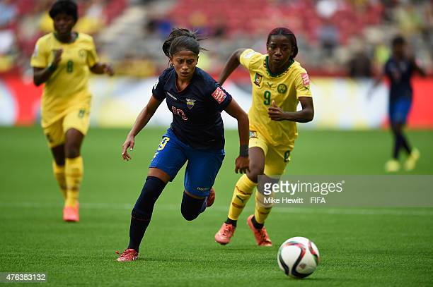 Kerlly Real of Ecuador holds off a challenge from Madeleine Ngono Mani of Cameroon during the FIFA Women's World Cup 2015 Group C match between...