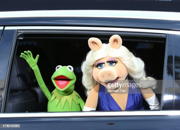 Kermit and Miss Piggy arrive at the Los Angeles premiere of 'Muppets Most Wanted' held at the El Capitan Theatre on March 11 2014 in Hollywood...