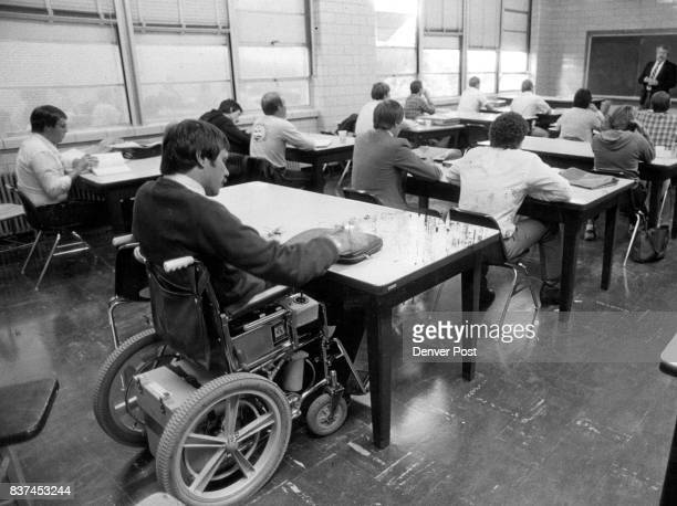 Kermit Breyer a quadraplegic MBA candidate at Regis College in Denver sits in class Tuesday evening at Regis Instructed by Richard C Mosher of the...