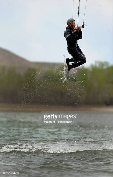 Kermit Lohry of Boulder gets some air while he kite surfs on Boulder reservoir He has been kite surfing for 12 years Boulder Reservoir was chock full...