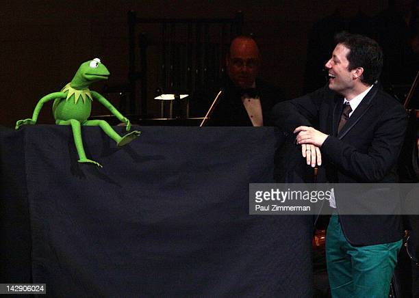 Kermit the Frog and host John Tartaglia perform during the The New York Pops Present 'Jim Henson's Musical World' at Carnegie Hall on April 14 2012...