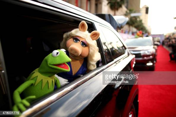 Kermit the Frog and Miss Piggy arrive at the world premiere of Disney's 'Muppets Most Wanted' at the El Capitan Theatre on March 11 2014 in Hollywood...