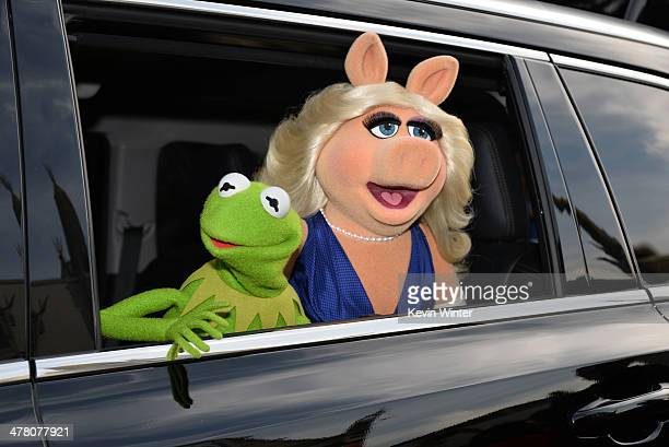 Kermit the Frog and Miss Piggy arrive for the premiere of Disney's 'Muppets Most Wanted' at the El Capitan Theatre on March 11 2014 in Hollywood...