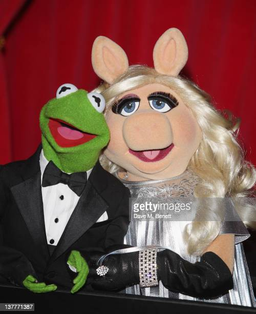 Kermit the Frog and Miss Piggy attend the UK premiere of 'The Muppets' at The Mayfair Hotel on January 26 2012 in London England