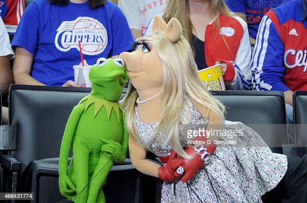 Kermit the Frog and Miss Piggy pose for the kiss camera during the Houston Rockets against the Los Angeles Clippers game on March 15 2015 at STAPLES...