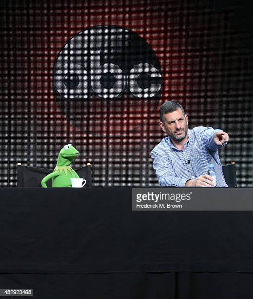 Kermit the Frog and writer/executive producer Bob Kushell speak onstage during the 'The Muppets' panel discussion at the ABC Entertainment portion of...