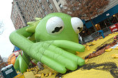 Kermit the Frog balloon being inflated the night day Macys 77th Annual Thanksgiving Day Parade
