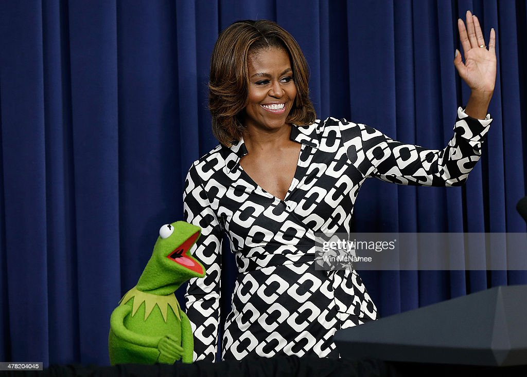 Kermit the Frog is welcomed by US first lady Michelle Obama at a screening of Disney's 'Muppets Most Wanted' at the Eisenhower Executive Office...