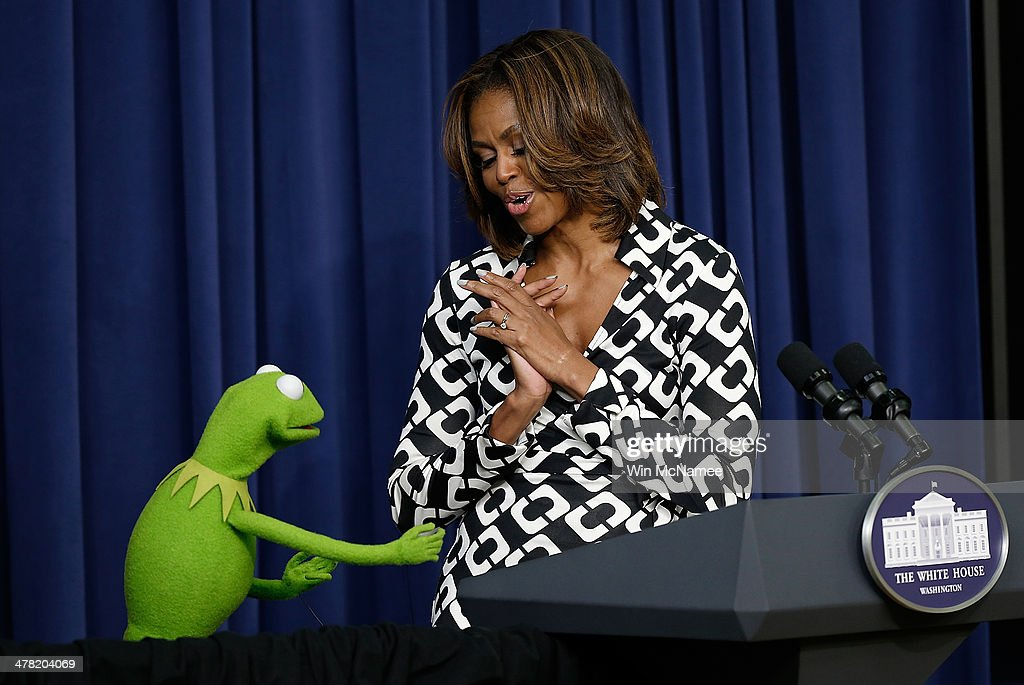 Kermit the Frog joins U.S. first lady <a gi-track='captionPersonalityLinkClicked' href=/galleries/search?phrase=Michelle+Obama&family=editorial&specificpeople=2528864 ng-click='$event.stopPropagation()'>Michelle Obama</a> at a screening of Disney's 'Muppets Most Wanted' at the Eisenhower Executive Office Building March 12, 2014 in Washington, DC. The movie's preview was for an audience of military children and families as part of the Joining Forces Initiative.
