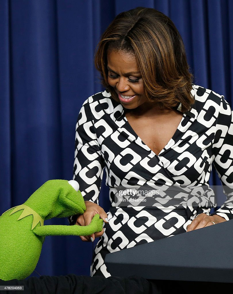 Kermit the Frog kisses the hand of U.S. first lady <a gi-track='captionPersonalityLinkClicked' href=/galleries/search?phrase=Michelle+Obama&family=editorial&specificpeople=2528864 ng-click='$event.stopPropagation()'>Michelle Obama</a> at a screening of Disney's 'Muppets Most Wanted' at the Eisenhower Executive Office Building March 12, 2014 in Washington, DC. The movie's preview was for an audience of military children and families as part of the Joining Forces Initiative.