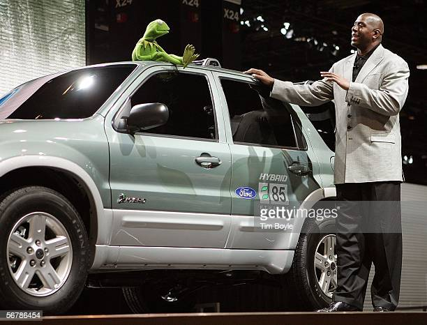 Kermit the Frog talks with Earvin 'Magic' Johnson atop a new Ford Escape Hybrid sport utility vehicle at the Chicago Auto Show February 8 2006 in...