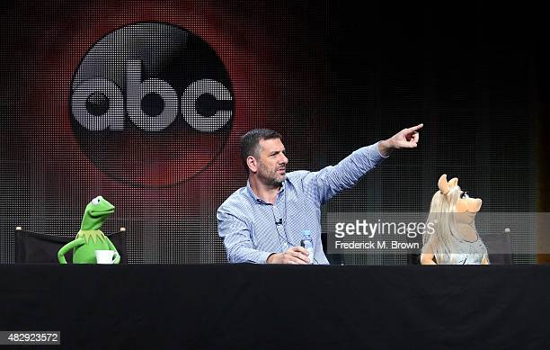 Kermit the Frog writer/executive producer Bob Kushell and Miss Piggy speak onstage during the 'The Muppets' panel discussion at the ABC Entertainment...