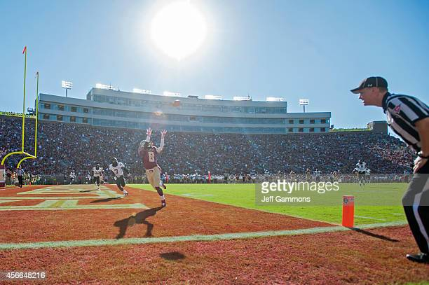 Kermit Whitfield of the Florida State Seminoles attempts to reel in a touchdown pass during the First half at Doak Campbell Stadium on October 4 2014...