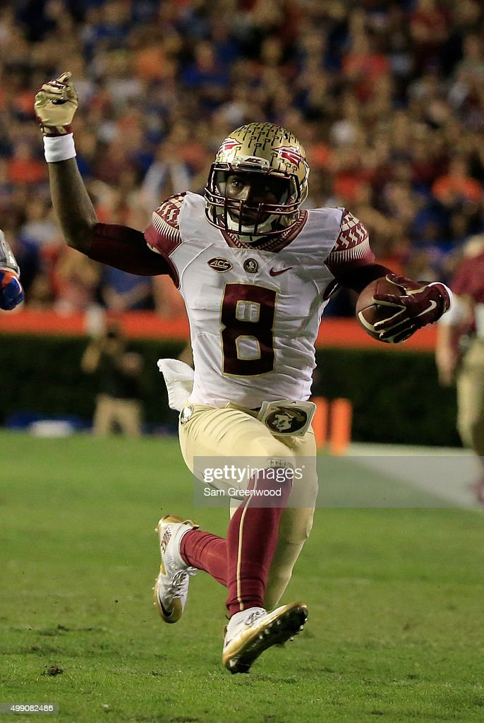 Kermit Whitfield of the Florida State Seminoles runs for yardage during the game against the Florida Gators at Ben Hill Griffin Stadium on November...