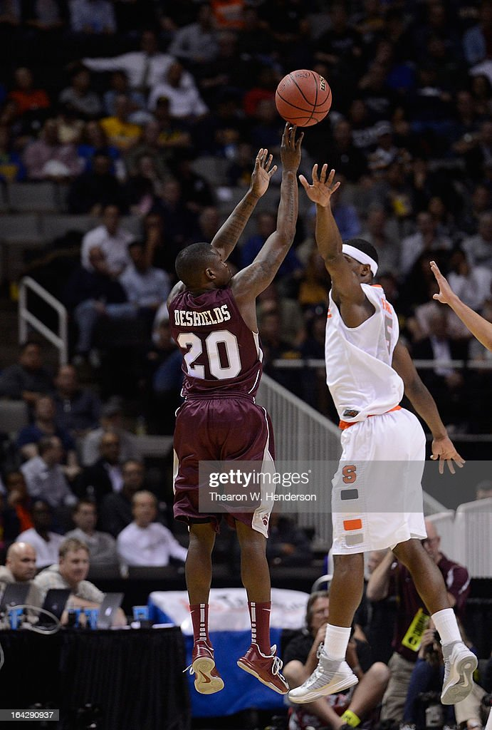 Keron DeShields #20 of the Montana Grizzlies shoots over <a gi-track='captionPersonalityLinkClicked' href=/galleries/search?phrase=C.J.+Fair&family=editorial&specificpeople=7366451 ng-click='$event.stopPropagation()'>C.J. Fair</a> #5 of the Syracuse Orange in the first half during the second round of the 2013 NCAA Men's Basketball Tournament at HP Pavilion on March 21, 2013 in San Jose, California.