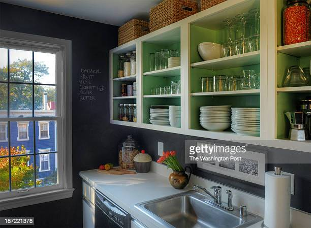 Kerra Michele Huerta and her tiny apartment on October 2013 in Washington DC Pictured Kerra has removed the kitchen cabinet doors and painted the...