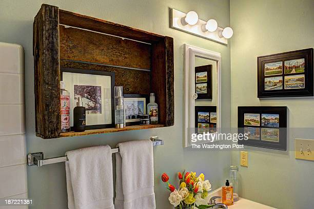 Kerra Michele Huerta and her tiny apartment on October 2013 in Washington DC Pictured the bathroom has been painted and a rustic grape crate...