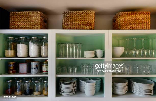 Kerra Michele Huerta and her tiny apartment on October 2013 in Washington DC Pictured Kerra has removed the doors to her kitchen cabinets and painted...