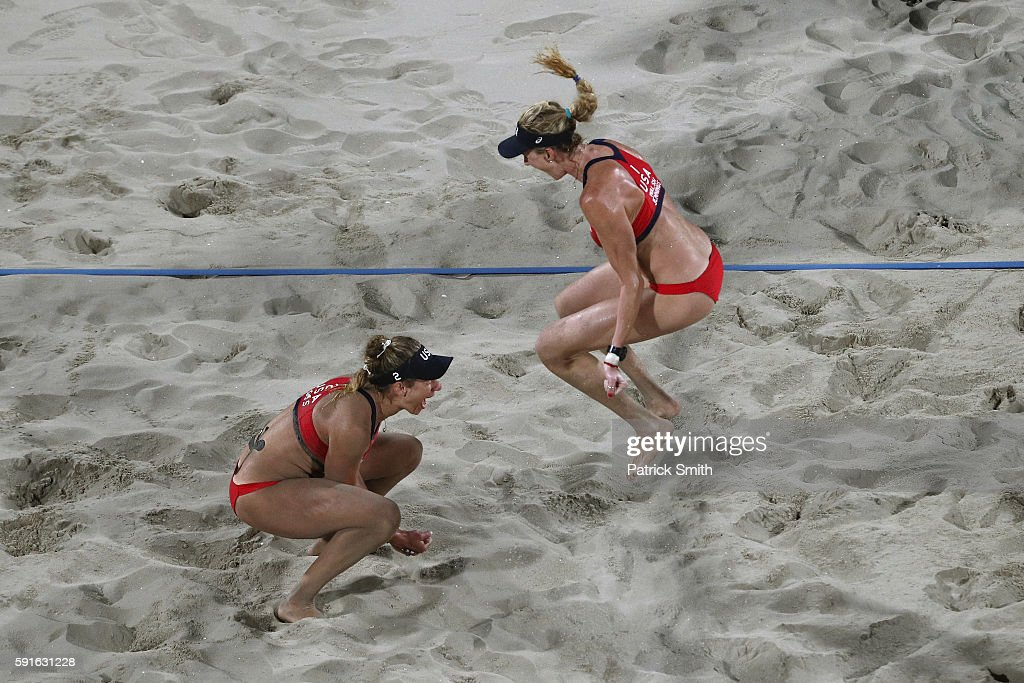 Kerri Walsh Jennings and April Ross of the United States celebrate winning match point during the Beach Volleyball Women's Bronze medal match against...