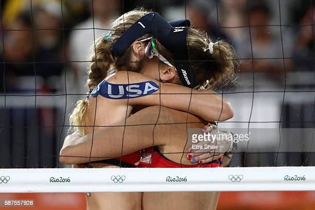 Kerri Walsh Jennings and April Ross of United States celebrate after winning the Women's Beach Volleyball preliminary round Pool C match against Fan...