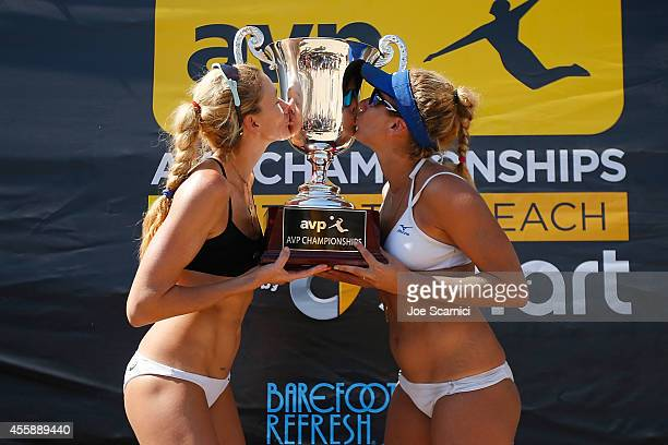 Kerri Walsh Jennings and April Ross pose with the trophy after winning the women's final at the AVP Championships at Huntington Beach on September 21...