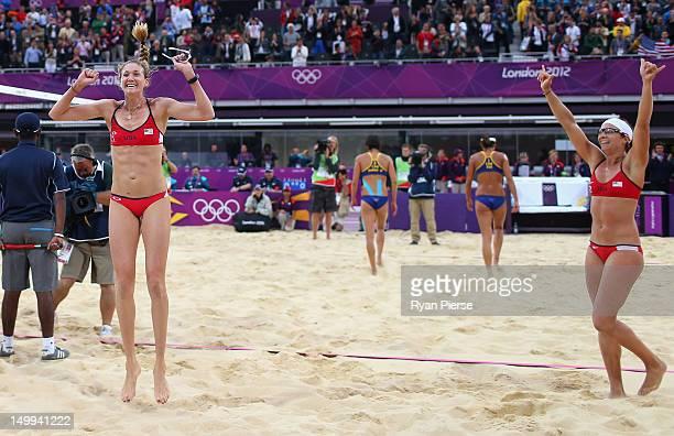 Kerri Walsh Jennings and Misty MayTreanor of the United States of the United States celebrate after the Women's Beach Volleyball Semi Final match...