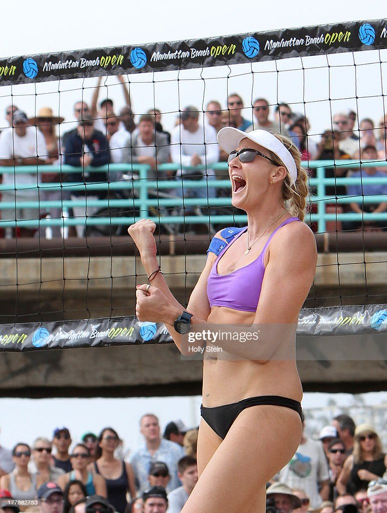 <a gi-track='captionPersonalityLinkClicked' href=/galleries/search?phrase=Kerri+Walsh&family=editorial&specificpeople=162761 ng-click='$event.stopPropagation()'>Kerri Walsh</a> Jennings celebrates after scoring during the women's finals at the AVP Manhattan Beach Open on August 25, 2013 in Manhattan Beach, California. Walsh Jennings and her partner Whitney Pavlik defeated Brooke Sweat and Jennifer Fopma 22-20, 21-17.