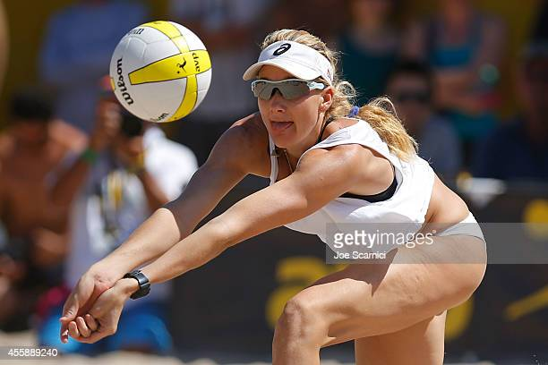 Kerri Walsh Jennings digs the ball during the women's final against Heather Hughes and Whitney Pavlik at the AVP Championships at Huntington Beach on...