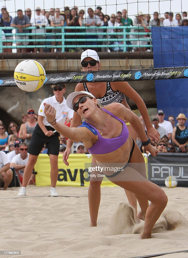 <a gi-track='captionPersonalityLinkClicked' href=/galleries/search?phrase=Kerri+Walsh&family=editorial&specificpeople=162761 ng-click='$event.stopPropagation()'>Kerri Walsh</a> Jennings digs the ball while opponent Jennifer Fopma watches during the women's finals at the AVP Manhattan Beach Open on August 25, 2013 in Manhattan Beach, California. Walsh Jennings and her partner Whitney Pavlik defeated Brooke Sweat and Jennifer Fopma 22-20, 21--17.