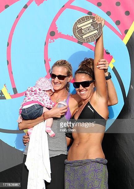 Kerri Walsh Jennings holding her new baby Scout and her partner Whitney Pavlik show their plaque which will go on the Manhattan Beach Pier after they...