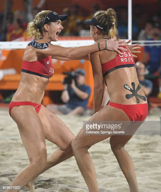 Kerri Walsh Jennings left celebrates with US teammate April Ross after a bronzemedal win against Brazil's Larissa Franca Maestri and Talita Rocha in...