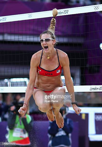 Kerri Walsh Jennings of the United States celebrates after winning match point during the Women's Beach Volleyball Semi Final match between United...