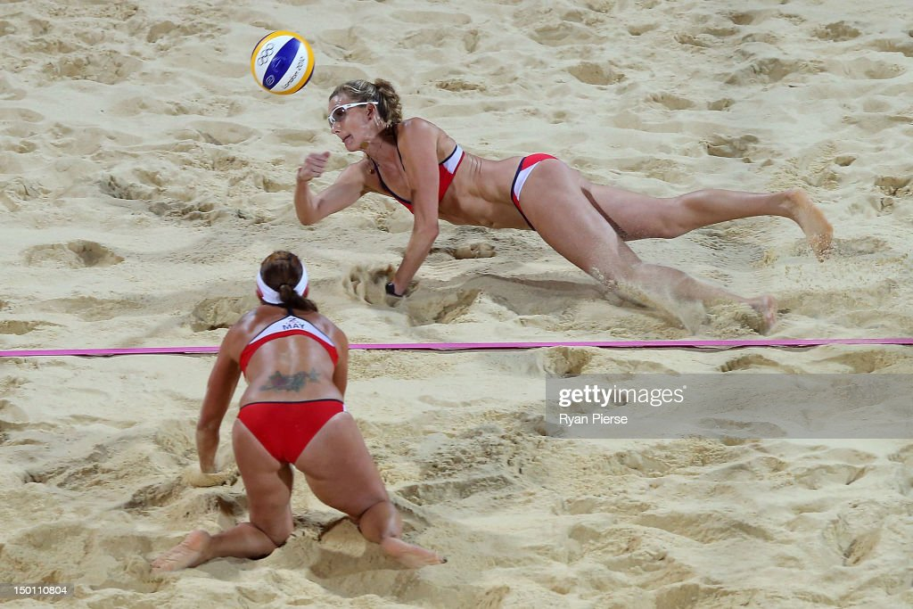 Kerri Walsh Jennings of the United States dives for the ball during the Women's Beach Volleyball Gold medal match against the United States on Day 12...
