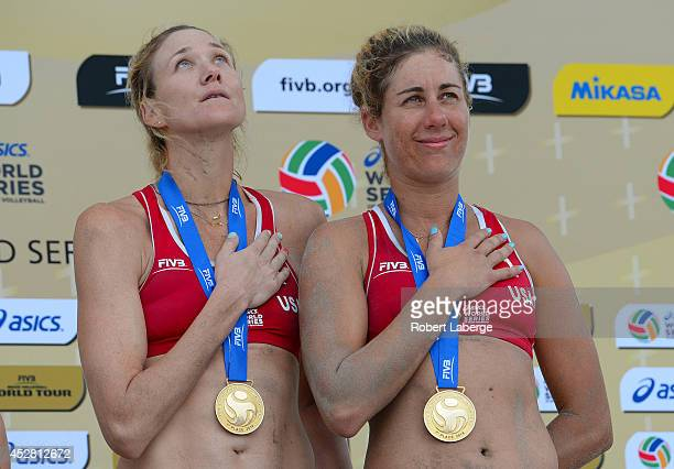 Kerri Walsh Jennings of the United States with April Ross on the podium after earning the Gold Medal during the FIVB Long Beach Grand Slam on July 27...