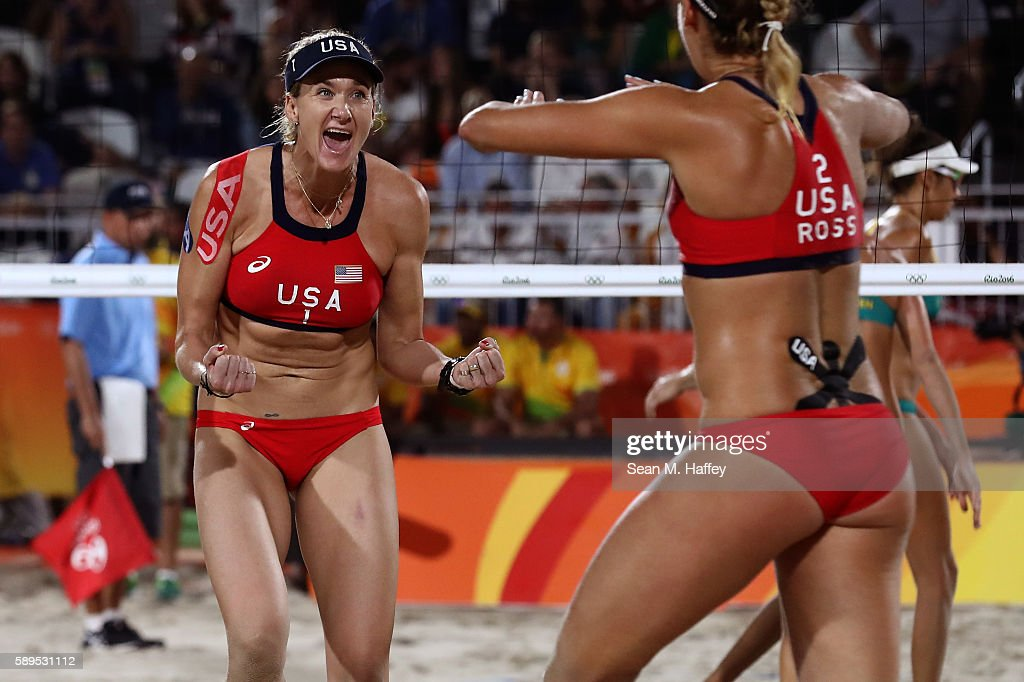 Kerri Walsh Jennings of United States celebrates a point with teammate April Ross during a Women's Quarterfinal match between the United States and...