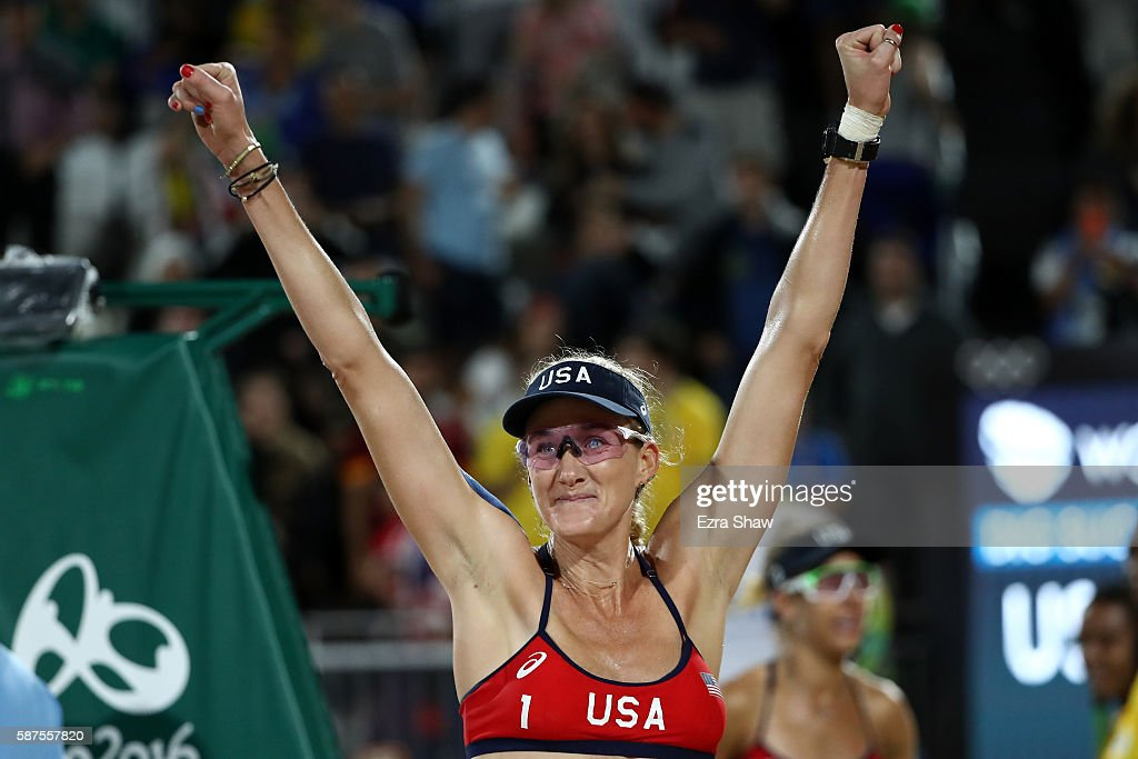 Kerri Walsh Jennings of United States celebrates after winning the Women's Beach Volleyball preliminary round Pool C match against Fan Wang and Yuan...