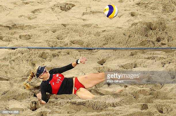 Kerri Walsh Jennings playing reached for the ball with her foot playing with April Ross of the United States against Isabelle Forrer and Anouk...