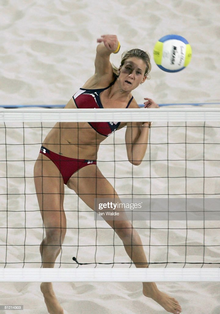 Kerri Walsh of United States spikes the ball during the match against Adriana Behar and Bede Shelda of Brazil in the women's gold medal Beach...