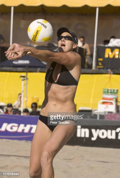 Kerri Walsh the Olympic Beach Volleyball Gold Medalist bump sets a ball to partner Misty May in a AVP game at Fort Lauderdale Florida on April 3 2005
