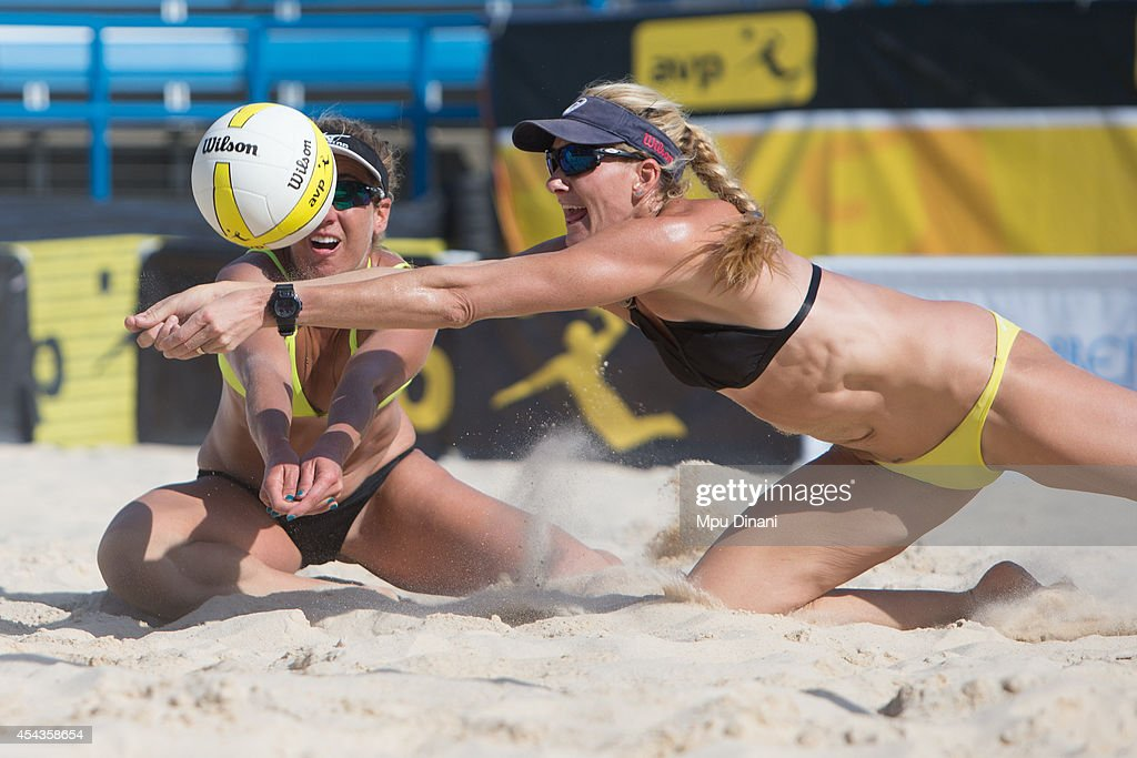 Kerri Walsh-Jennings (R) and <a gi-track='captionPersonalityLinkClicked' href=/galleries/search?phrase=April+Ross&family=editorial&specificpeople=4296381 ng-click='$event.stopPropagation()'>April Ross</a> (L) attempt to dig the ball at the 2014 AVP Cincinnati Open on August 29, 2014 at the Lindner Family Tennis Center in Cincinnati, Ohio.