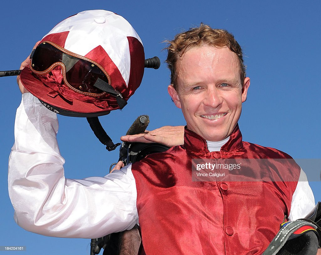 Kerrin McEvoy poses for photo after winning the Beck Caulfield Guineas aboard Long John during Melbourne Racing at Caulfield Racecourse on October 12, 2013 in Melbourne, Australia.