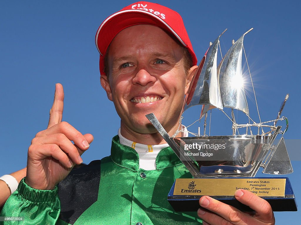 Kerrin McEvoy poses with the trophy after winning on Turn Me Loose in race 7 the Emirates Stakes on Stakes Day at Flemington Racecourse on November 7, 2015 in Melbourne, Australia.