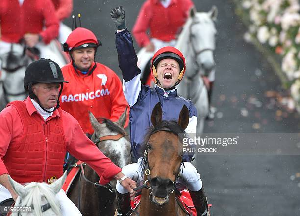 Kerrin McEvoy reacts after winning the Melbourne Cup on Almandin at Flemington Racecourse in Melbourne on November 1 2016 Almandin pipped Heartbreak...