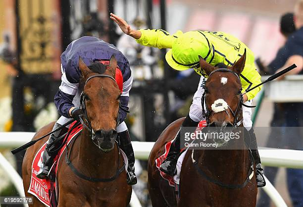 Kerrin McEvoy riding Almandin gets a pat on the back from Joao Moreira riding Heartbreak City after winning race 7 the Emirates melbourne Cup on...