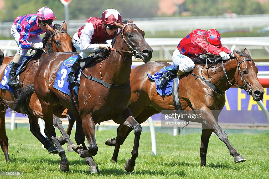Kerrin McEvoy riding Kuroshio (L) wins the Patinack Farm Blue Diamond Prelude (C&G) from Craig Newitt riding The Bowler during Melbourne Racing at Caulfield Racecourse on February 9, 2013 in Melbourne, Australia.