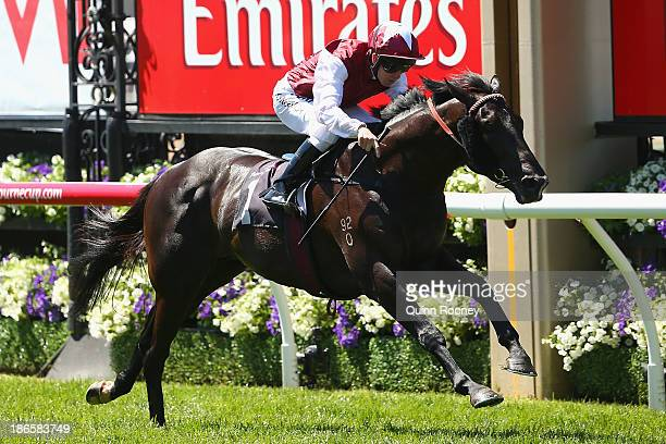 Kerrin McEvoy riding Paximadia crosses the line to win race 1 the Carbine Club Stakes during Derby Day at Flemington Racecourse on November 2 2013 in...