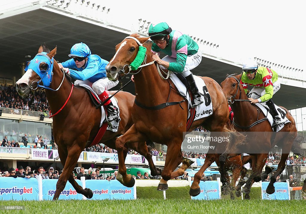 Kerrin McEvoy riding Vibrant Rouge crosses the line to win the City Jeep Handicap during Cox Plate Day at Moonee Valley Racecourse on October 26, 2013 in Melbourne, Australia.