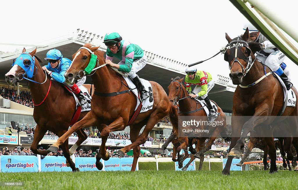 Kerrin McEvoy riding Vibrant Rouge crosses the line to win the City Jeep Handicap just infront of Clare Lindop riding Nearest to Pin during Cox Plate Day at Moonee Valley Racecourse on October 26, 2013 in Melbourne, Australia.