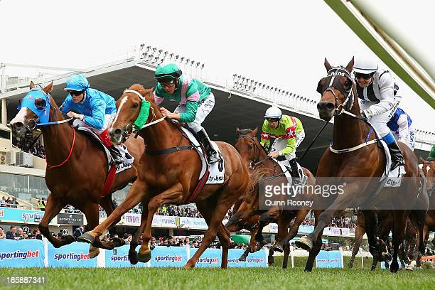 Kerrin McEvoy riding Vibrant Rouge crosses the line to win the City Jeep Handicap just infront of Clare Lindop riding Nearest to Pin during Cox Plate...