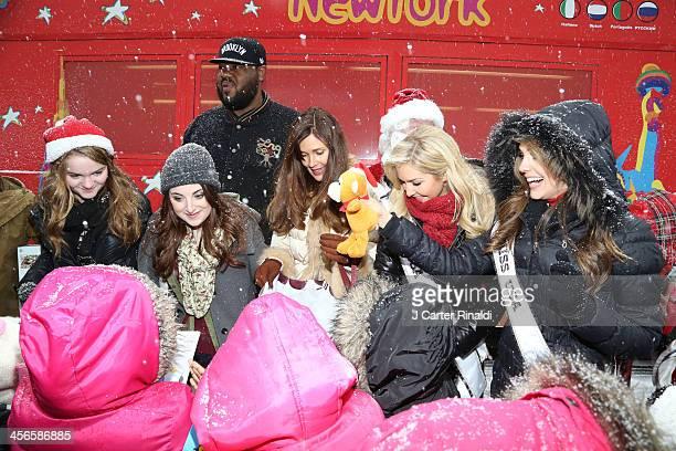 Kerris Dorsey Juliette Goglia Griz Chapman Carol Alt Cassidy Wolf and Erin Brady attend City Sightseeing New York 2013 holiday toy drive at PAL's...